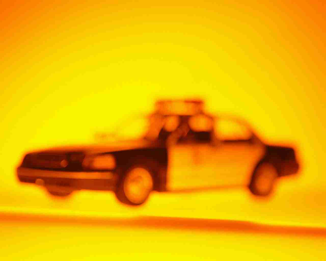 Toy Police Car in Yellow Light