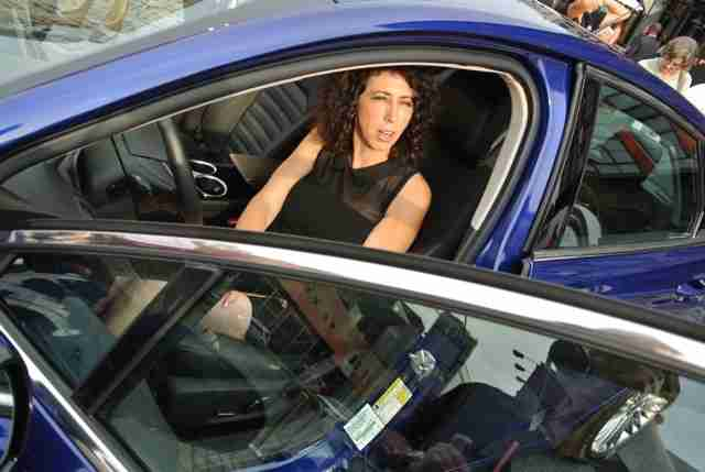 Lauren Fix in a Ford Fusion