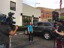 "Lauren Fix , The Car Coach shooting web episodes for PNC's ""Backseat Driver."""