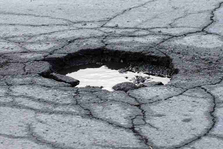 dangerous pothole driving safety