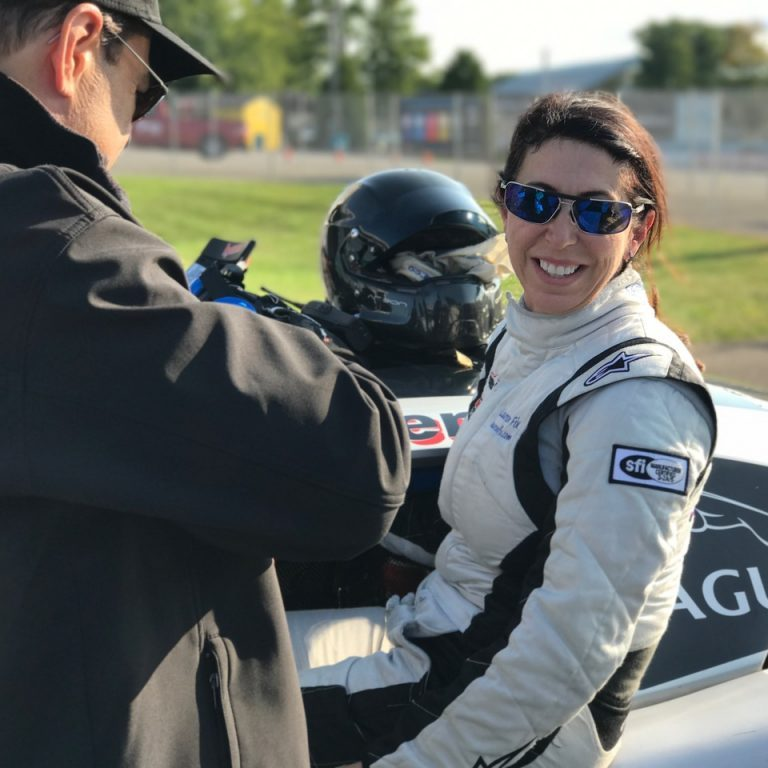 Lauren racing the Jaguar at Watkins Glen
